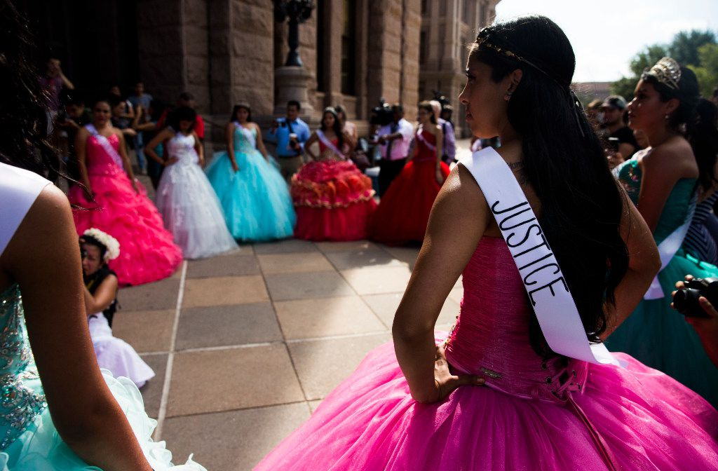 "Leslie Abraham wore a ""justice"" sash as she and other teenage girls with Jolt Texas hold symbolic quinceaneras to protest the sanctuary cities ban on Wednesday outside the Texas Capitol in Austin."