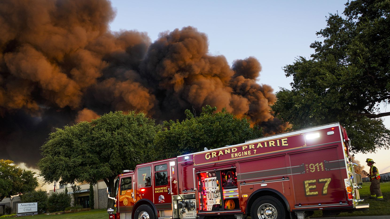 Fire crews battle a massive blaze in an industrial area of Grand Prairie just before sunrise on Wednesday.