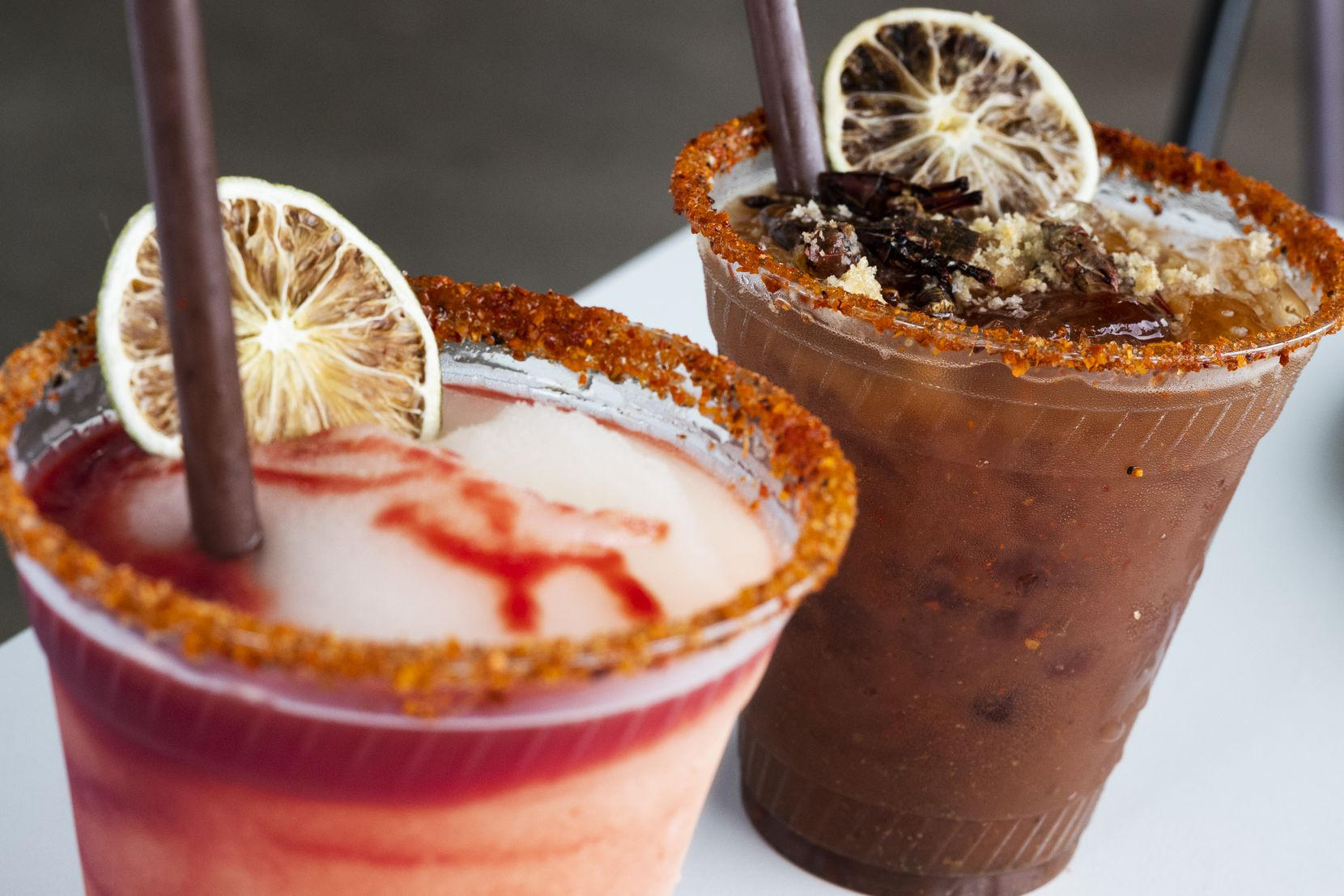 Of course, the reincarnated Tacos Mariachi has cocktails. Here's the Milagro Rita, left, with frozen blood orange; and The Cure, right, with mezcal, chicharron and chapulines (grasshoppers).