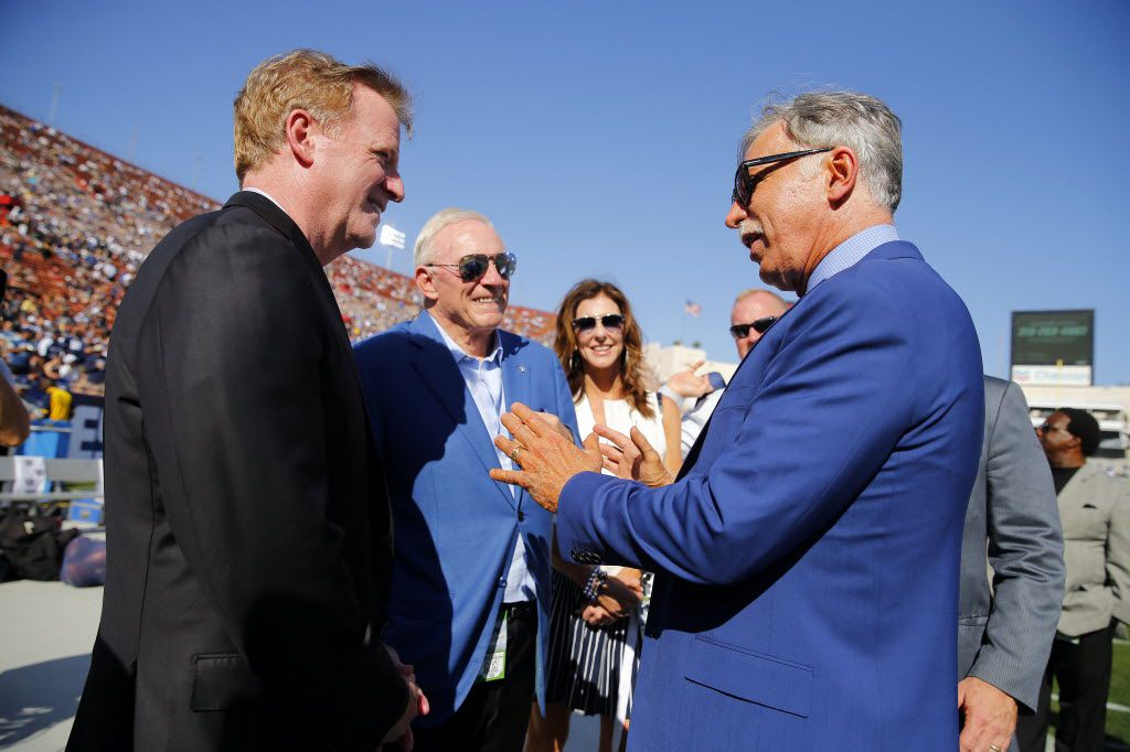 (from left) NFL Commissioner Roger Goodell, Dallas Cowboys owner Jerry Jones and Cowboys vice president Charlotte Jones Anderson listen to Los Angeles Rams owner Stan Kroenke tells stories before their first preseason game at the Memorial Coliseum in Los Angeles, California, Saturday, August 13, 2016.