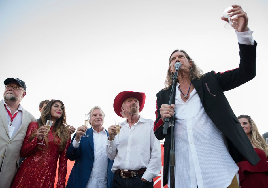 """Bill Hutchinson, right, toasts the new Virgin Hotel's ground breaking in Dallas. He's told he looks like Richard Branson, second from right. Hutchinson says of Branson, """"He looks like a middle-aged hippie, and I sorta do, too. I'm in awe of his business acumen and his success."""""""