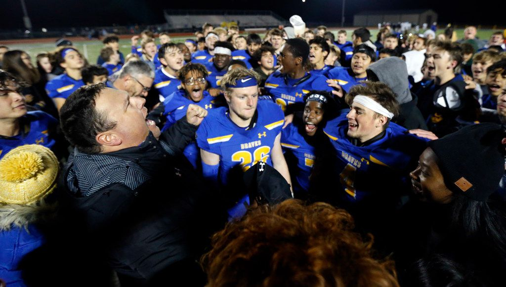 Community High head coach Jeremy Turner (left) exhaults after leading a postgame prayer with players and students at Community ISD Stadium in Nevada, Texas, Friday, November 8, 2019. Community defeated Roosevelt to advance to the playoffs. (Tom Fox/The Dallas Morning News)