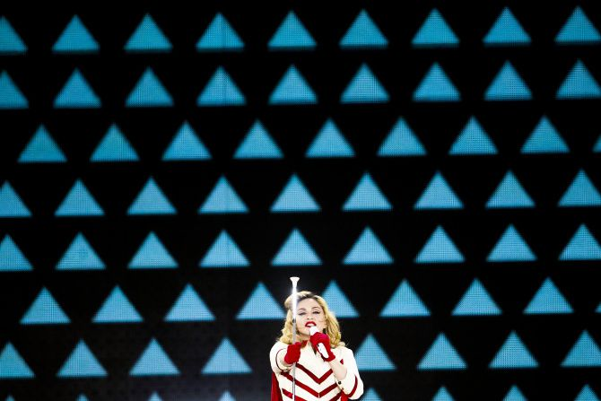 """Madonna performs """"Express Yourself"""" in front of a massive video graphic display at the American Airlines Center in Dallas,  TX. on Sunday Oct. 21, 2012."""