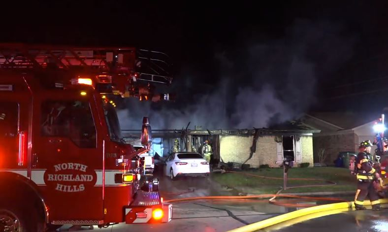 Firefighters battle a fatal blaze that broke out Thursday morning at a one-story home in Watauga. One person was killed, while two others got out.