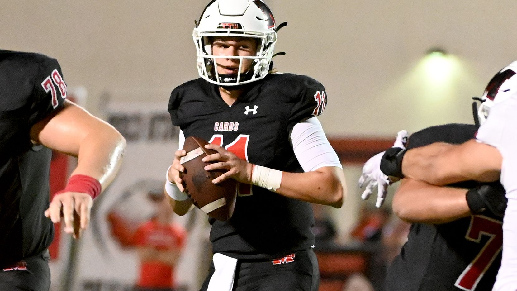 Melissa's quarterback Sam Fennegan (11) looks to pass in the first half of a high school football game between Argyle and Melissa, Friday, Oct. 1, 2021, in Melissa, Texas. (Matt Strasen/Special Contributor)