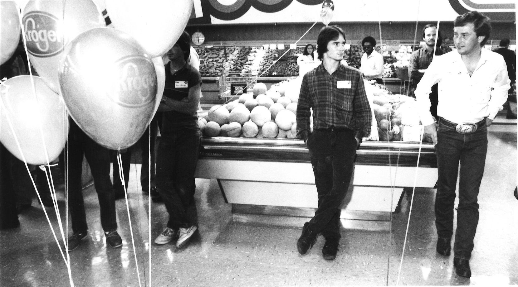 Michael Key (left) scans the produce department with a companion during the mingling period.