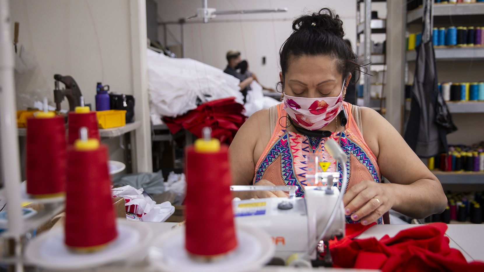 Seamstress Brenda Flores makes baby bloomers while wearing a mask at T&Q Cutting Services on May 2, 2020 in Dallas. Owner Rudy Romero has been helping supply hospitals and others with PPE such as face masks and gowns.