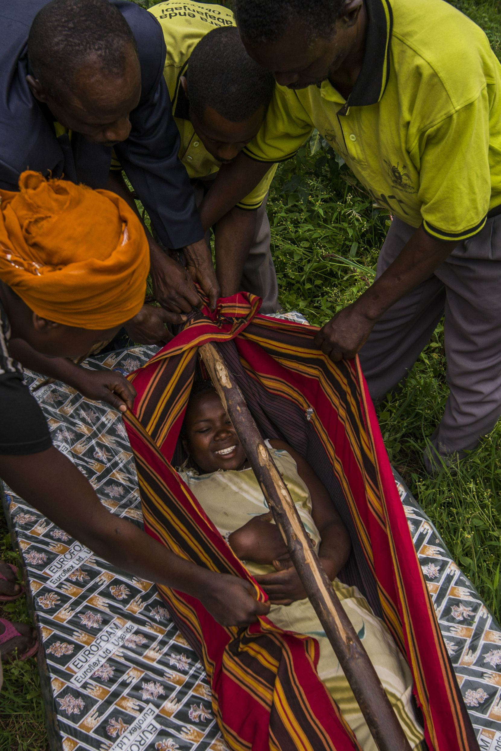 In this case in June 2014, villagers prepare to carry a woman in labor from her village to a child-birth facility. (Smiley N. Pool © 2014)