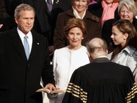 Chief Justice William Rehnquist delivers the oath of office as President George W. Bush is sworn in for a second term during  his Inauguration at the Capitol Building in Washington, DC,  Thursday morning, January 20, 2005. With the President, from left, are First Lady Laura Bush and twin daughters Barbara and Jenna Bush.