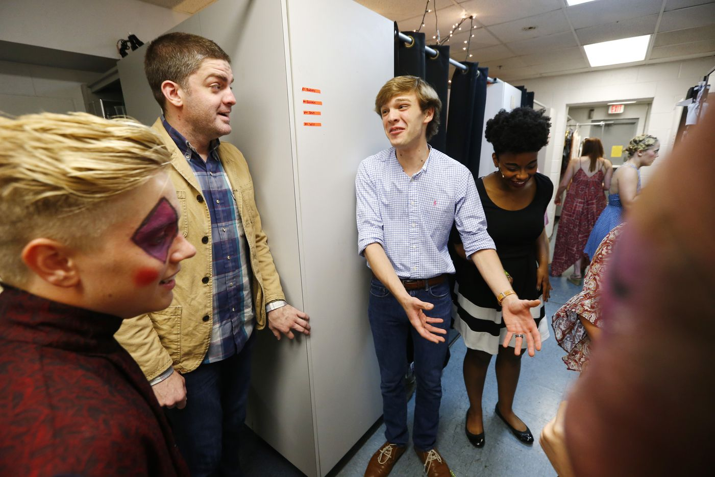 Director Derek Whitener (left, in jacket) talks to Will Carleton, who plays the lead, before opening night of Pippin at The Firehouse Theatre.