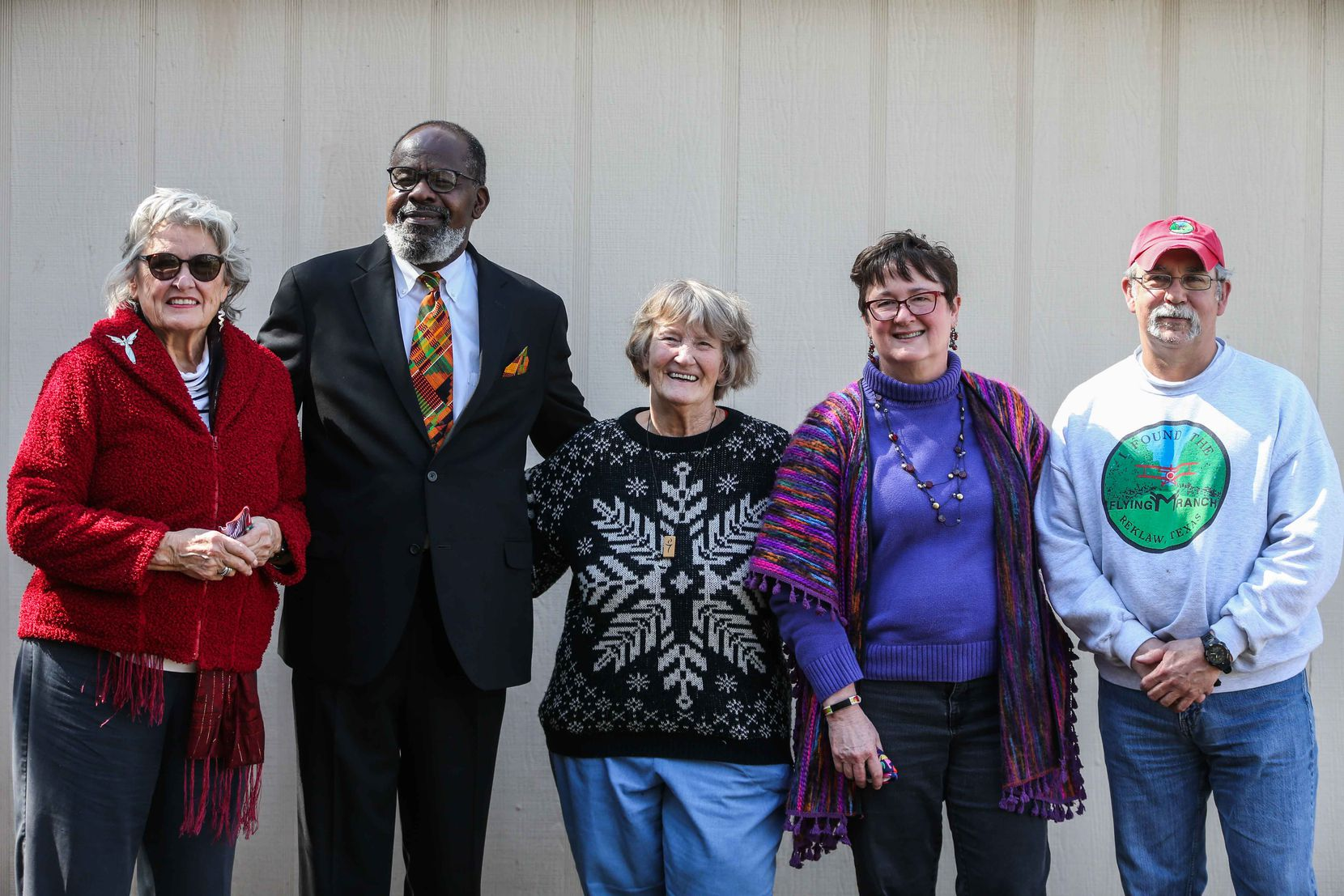 From left, Mary Sue Foster, Pastor Bobbyray Williams, Carol Uberbacher, Elizabeth Sutherland and Doug Taylor, pose together for a portrait at her home in Dallas on Sunday, February 21, 2021. Uberbacher lost power at her home after Winter storm Uri hit Dallas last Sunday, and Pastor Williams woke her up from hypothermic reaction after a Foster couldn't get in touch with her. Then Sutherland and Taylor took her home. (Lola Gomez/The Dallas Morning News)
