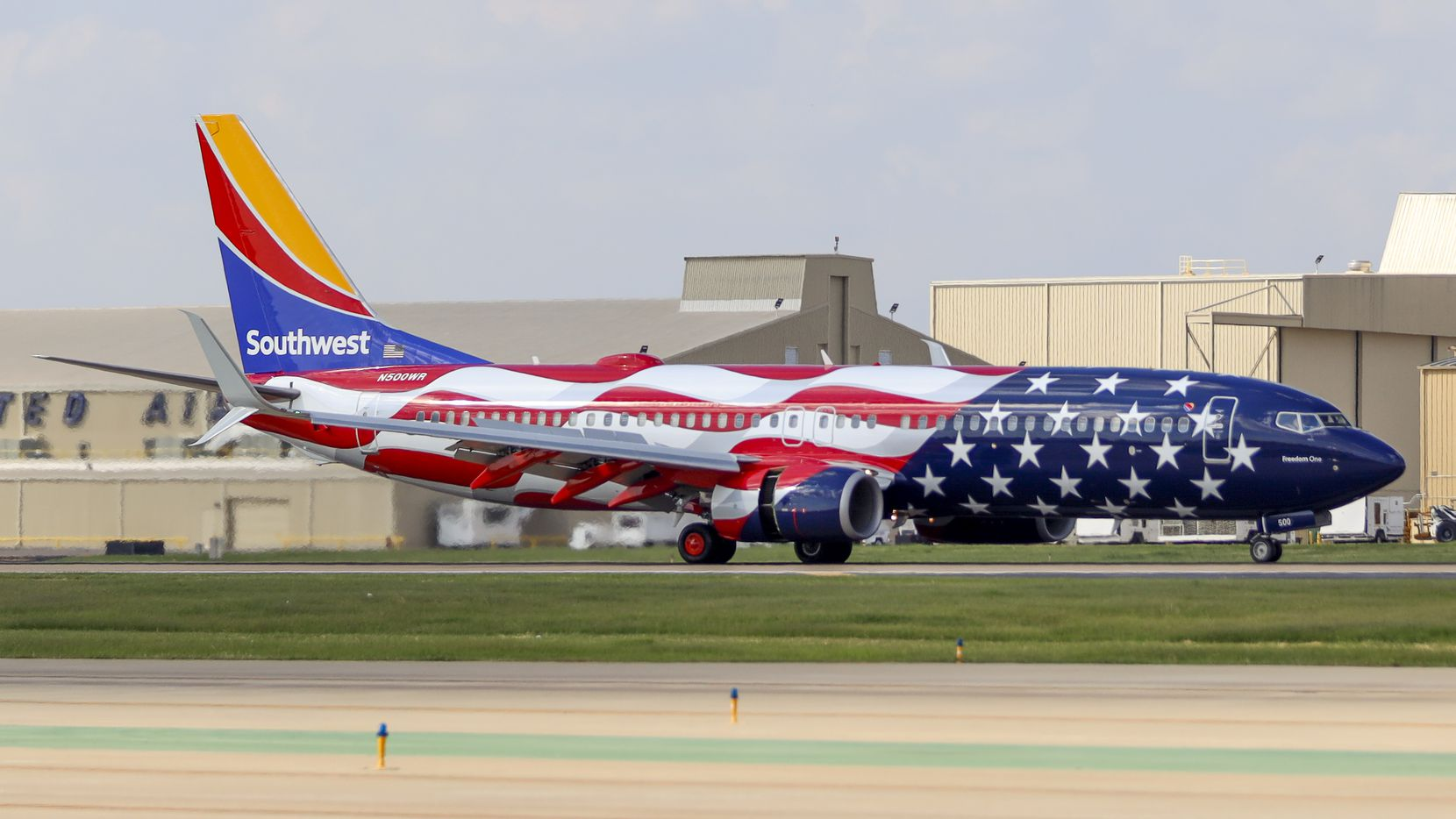 """A Southwest Airlines Boeing 737-800 named """"Freedom One"""" taxis to the gate at Dallas Love Field on Friday, June 18, 2021, in Dallas. (Elias Valverde II/The Dallas Morning News)"""