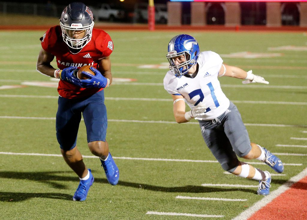 John Paul's Jerand Bradley (9) makes a reception and scores a touchdown as Nolan's Cael Ross (21) chases him during the first half of their TAPPS Division I second-round high school football playoff game in Grapevine, Tx, Friday, Nov. 22, 2019. (Michael Ainsworth)