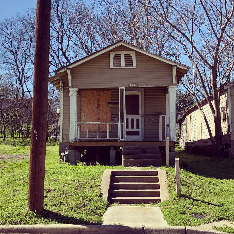 The boarded-up shotgun houses are part of Dallas history.