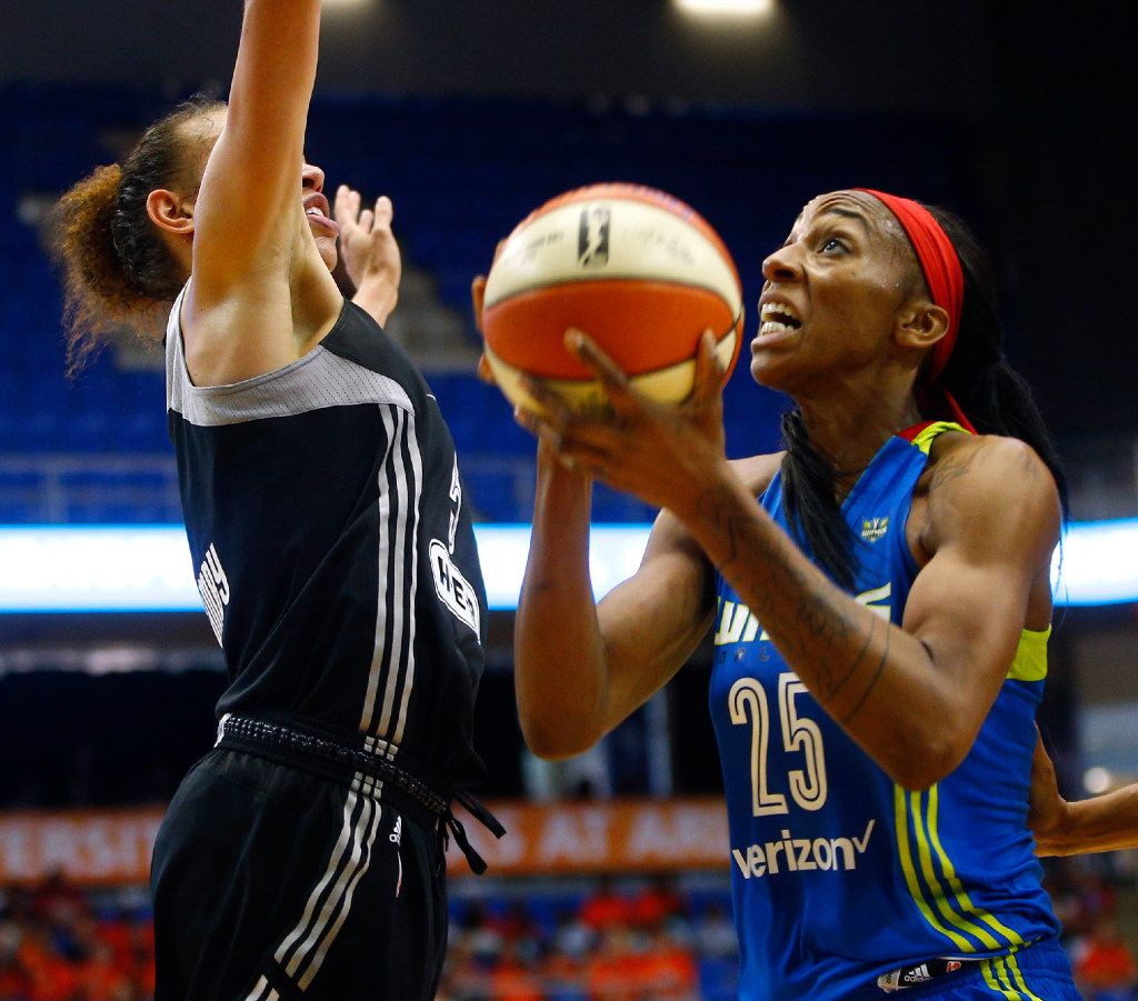 Dallas Wings forward Glory Johnson (25) shoots the ball around San Antonio Stars forward Dearica Hamby (5) in the second half of their game at UTA's College Park Center in Arlington, Texas on June 21, 2017.  (Nathan Hunsinger/The Dallas Morning News)