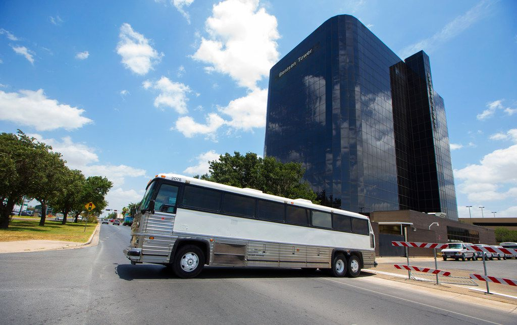 A bus of detained immigrants leaves the federal courthouse in McAllen, Texas on June 11, 2018. (Nathan Hunsinger/The Dallas Morning News)