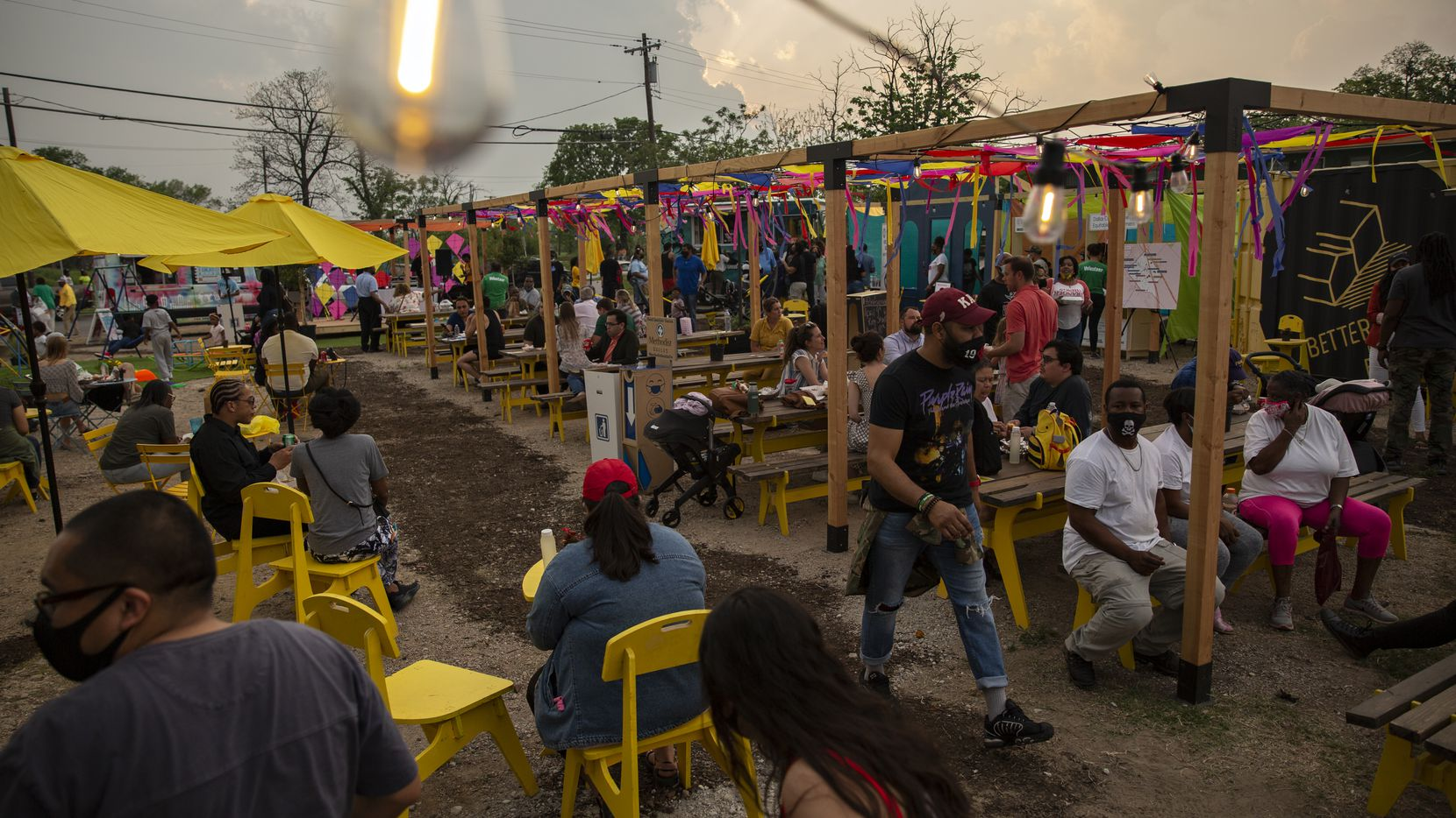 People enjoy the variety of food, live music, community gardens, and play area for the kids at the MLK Food Park in Dallas on April 9, 2021. The MLK Food Park will be tested for a month in South Dallas's Forest District.
