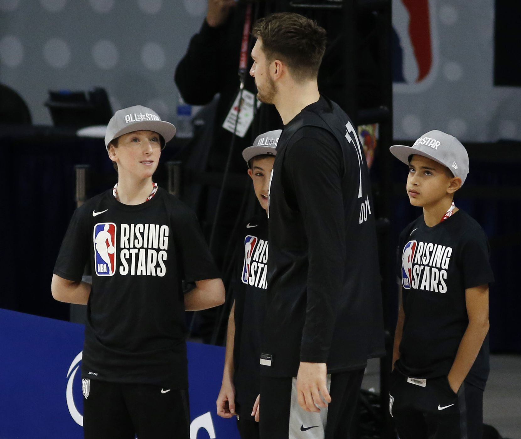 Kids look up to Dallas Mavericks forward Luka Doncic (77) as he walks by during the NBA Rising Stars practice for the World Team at Wintrust Arena during the NBA All Star 2020 event in Chicago on Friday, February 14, 2020.
