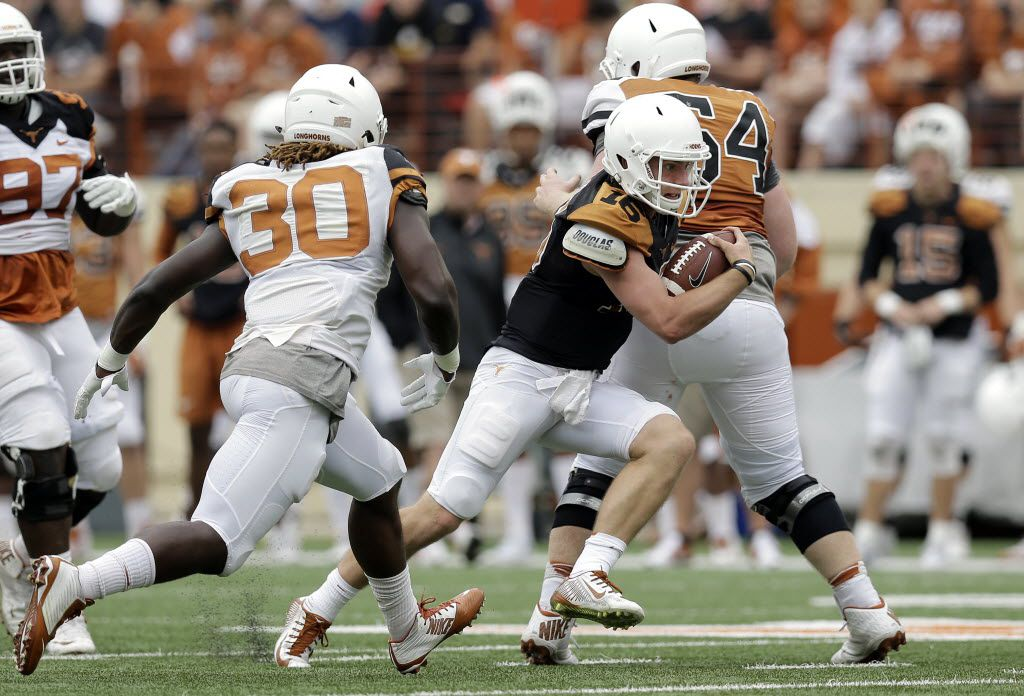 Texas quarterback Shane Buechele (16) scrambles for yards during a spring NCAA college football game, Saturday, April 16, 2016, in Austin, Texas. (AP Photo/Eric Gay)
