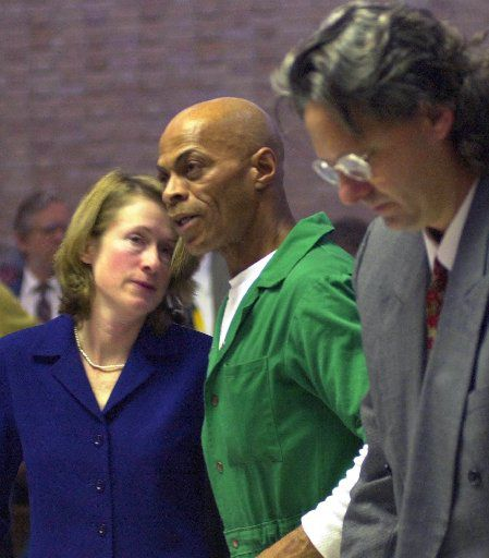 Attorneys John Blume (right) and Diana Holt worked together to seek a new trial for death row inmate Edward Lee Elmore. He was later freed from prison after taking a plea deal in the slaying of a 75-year-old widow in South Carolina.