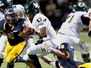 Longview High School quarterback Jordan Allen(12) is taken down by Highland Park High School linebacker Harrison Walton (45) as Highland Park High School Jack Curtis (95) closes in during the first half as Highland Park High School hosted Longview High School at Highlander Stadium in Dallas on Friday night, October 8, 2021. (Stewart F. House/Special Contributor)