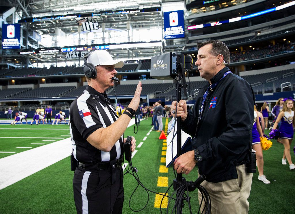 Referee Bill Tilley tests the instant replay screen on the field before the UIL 4A Division I state championship game between Waco La Vega and Liberty Hill on Friday, December 21, 2018 at AT&T Stadium in Arlington. (Ashley Landis/The Dallas Morning News)