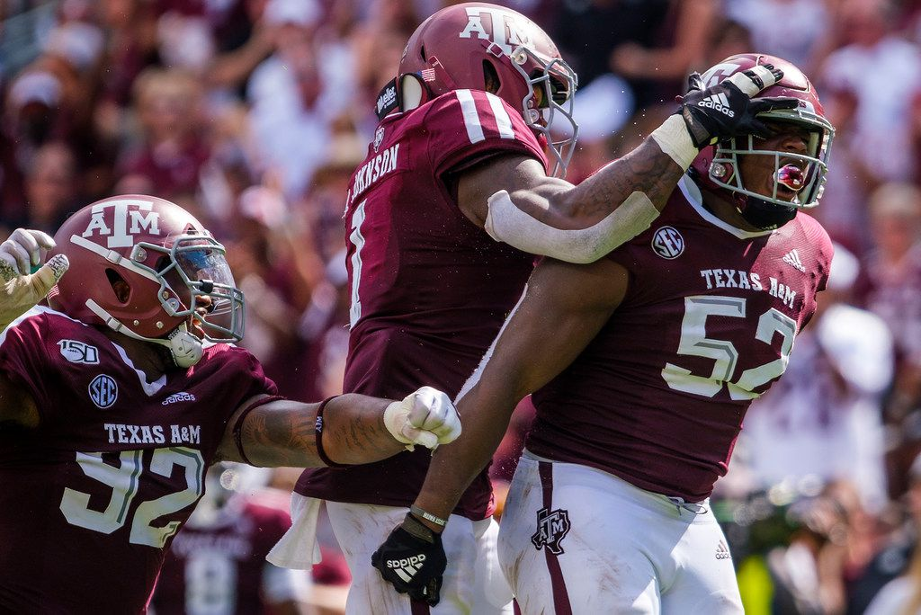 Texas A&M defensive lineman Justin Madubuike (52) celebrates with linebacker Buddy Johnson (1) and defensive lineman Jayden Peevy (92) after a stop in the second quarter of a game against Auburn at Kyle Field on Saturday, Sept. 21, 2019, in College Station.