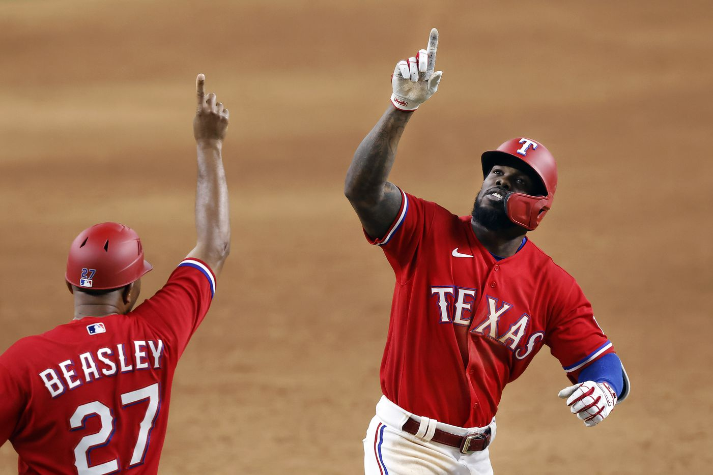 Texas Rangers batter Adolis Garcia (right) celebrates his walk off 3-run homer in the tenth inning Houston Astros at Globe Life Field in Arlington, Texas, Friday, May 21, 2021. It was the first walk off home run in Globe Life Field history, winning 7-5.  (Tom Fox/The Dallas Morning News)