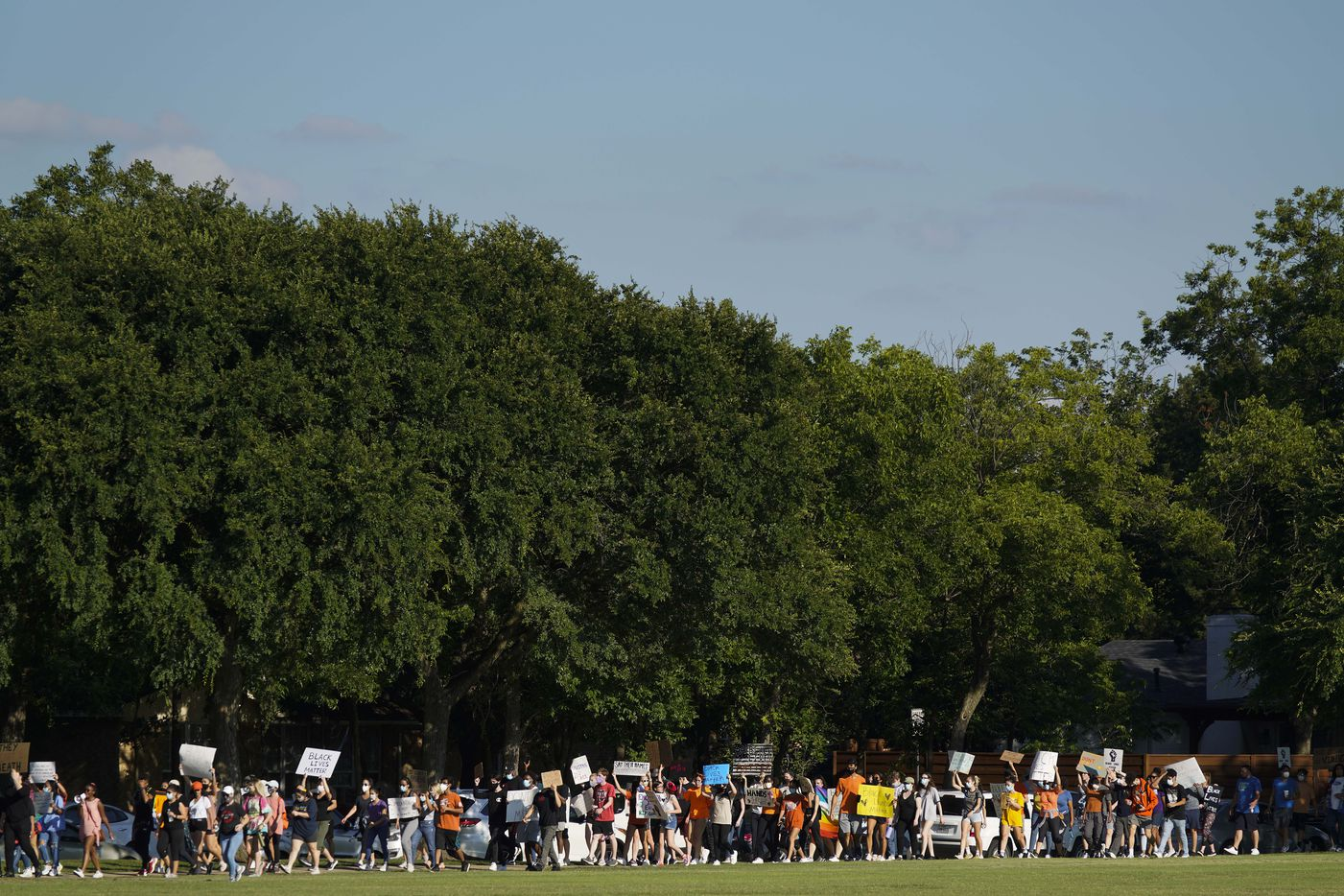 Demonstrators march around the perimeter of Berkner Park during a protest organized by Berkner High School students as protests continue after the death of George Floyd on Wednesday, June 3, 2020, in Richardson.