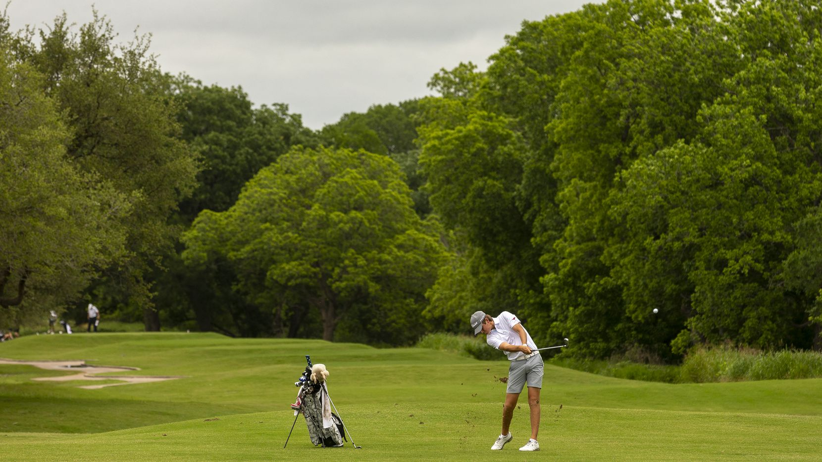 JJ PearceÕs Preston Stout hits from the fairway on the 14th hole during the final round of the UIL Class 6A boys golf tournament in Georgetown, Tuesday, May 18, 2021. (Stephen Spillman/Special Contributor)