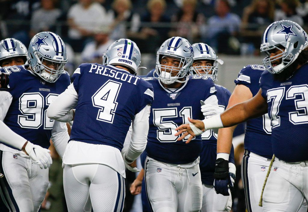 Dallas Cowboys quarterback Dak Prescott (4) welcomes the team onto the field for warmups prior to an NFL football game between the Dallas Cowboys and the Minnesota Vikings at AT&T Stadium in Arlington, Texas, on Sunday, Nov. 10, 2019.
