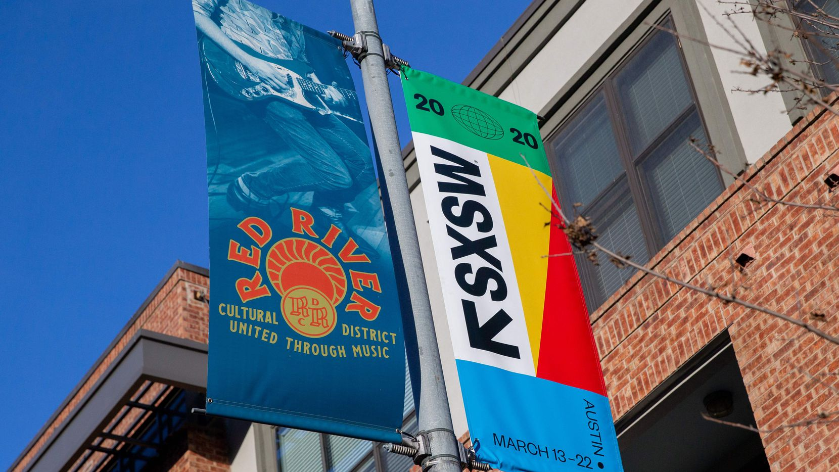 SXSW 2020 banners are seen in Austin on March 6, 2020 in Austin Texas. The South by Southwest festival in Texas has been cancelled due to concerns over the spread of the new coronavirus, organizers and the host city of Austin said on March 6, 2020.