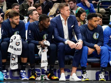 Kristaps Porzingis watches from the bench during the first half of an NBA basketball game against the Philadelphia 76ers at American Airlines Center on Saturday, Jan. 11, 2020, in Dallas.