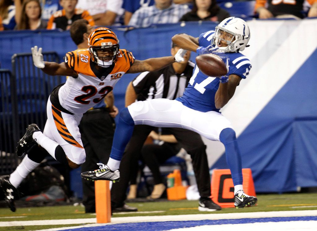 Indianapolis Colts wide receiver Justice Liggins (17) makes a catch in front of Cincinnati Bengals cornerback Bene' Benwikere (23) for a touchdown during the second half of a preseason NFL football game in Indianapolis, Thursday, Aug. 31, 2017. (AP Photo/AJ Mast)