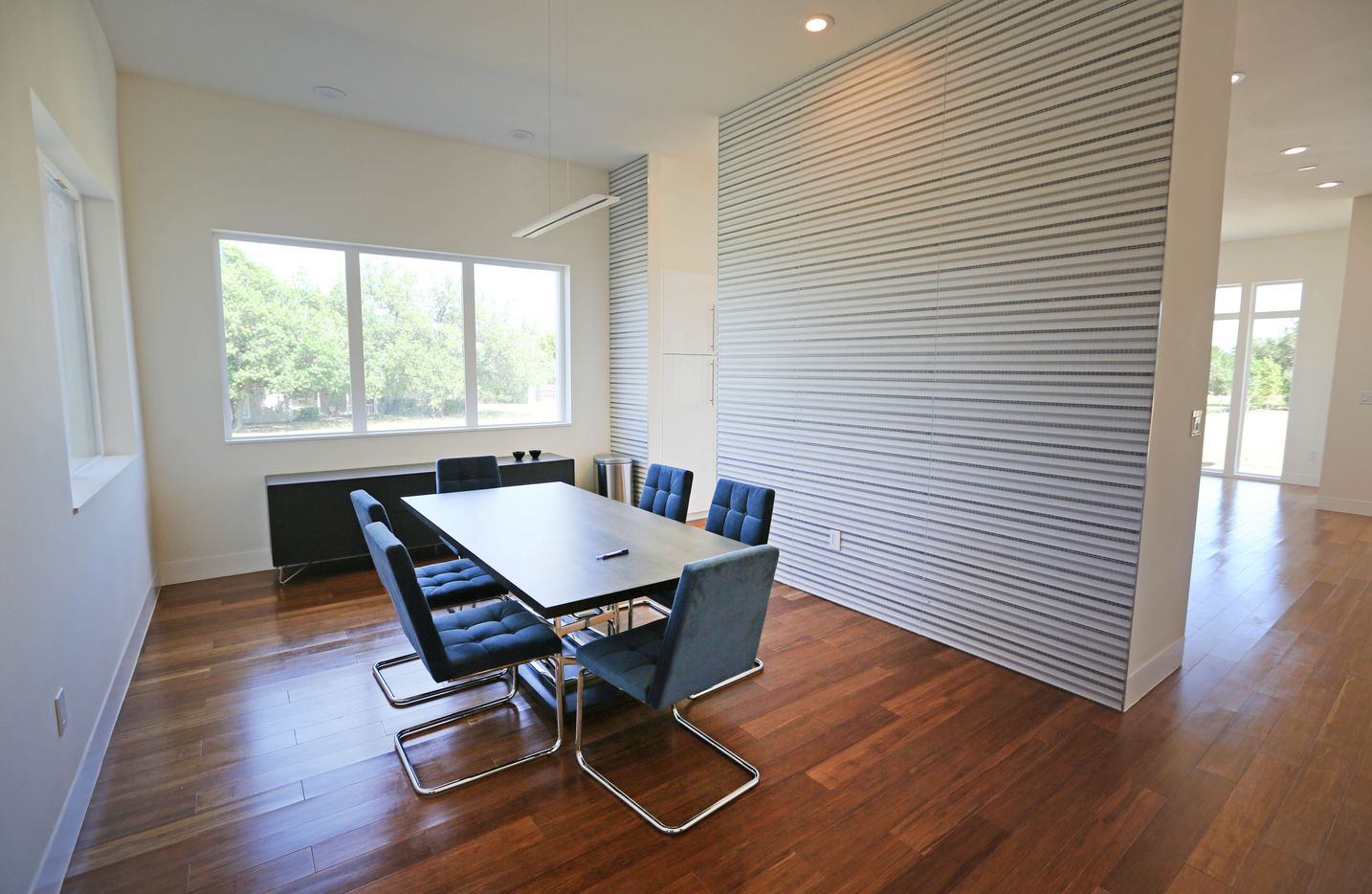 The dining room in the New Modern Home, a prototype house that builder Jimmy Tanghongs has built, which  needs no exterior maintenance and produces its own electricity.