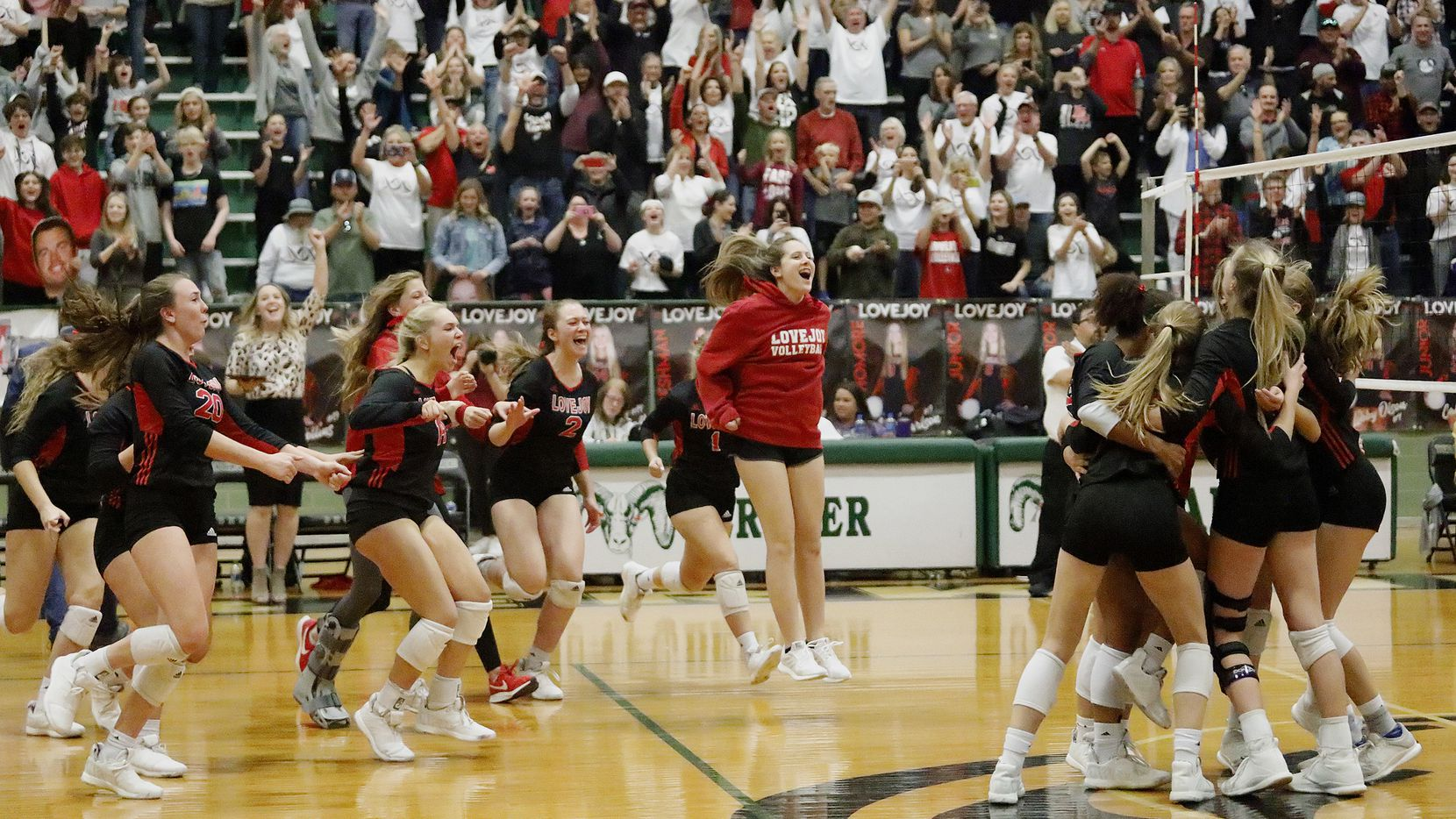 Lovejoy olayers celebrate after the final point of Saturday's 25-20, 25-14, 25-17 win over Highland Park in the Class 5A Region II championship match at Richardson Berkner High School. (Stewart F. House/Special Contributor)
