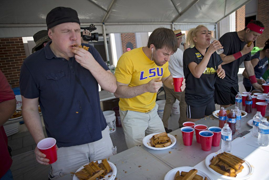 (From left) Nate Biller, Adrian Morgan, Miki Sudo and Erik Denmark take part in the Western Days Festival World Tamale Eating Championship Saturday, September 26, 2015 in Lewisville, Texas. A dozen competitors took part in the event, with the winner consuming 61 tamales in 12 minutes. (G.J. McCarthy/The Dallas Morning News)
