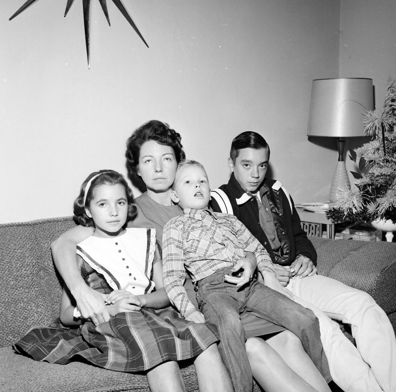 Marie Tippit and her children, Brenda, Curtis and Charles Allan, the day after J.D. Tippit was shot and killed.