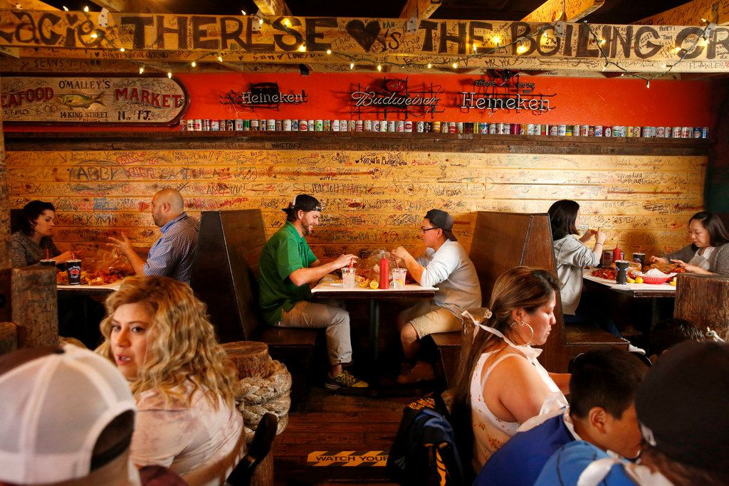 People eat seafood at The Boiling Crab in Dallas.