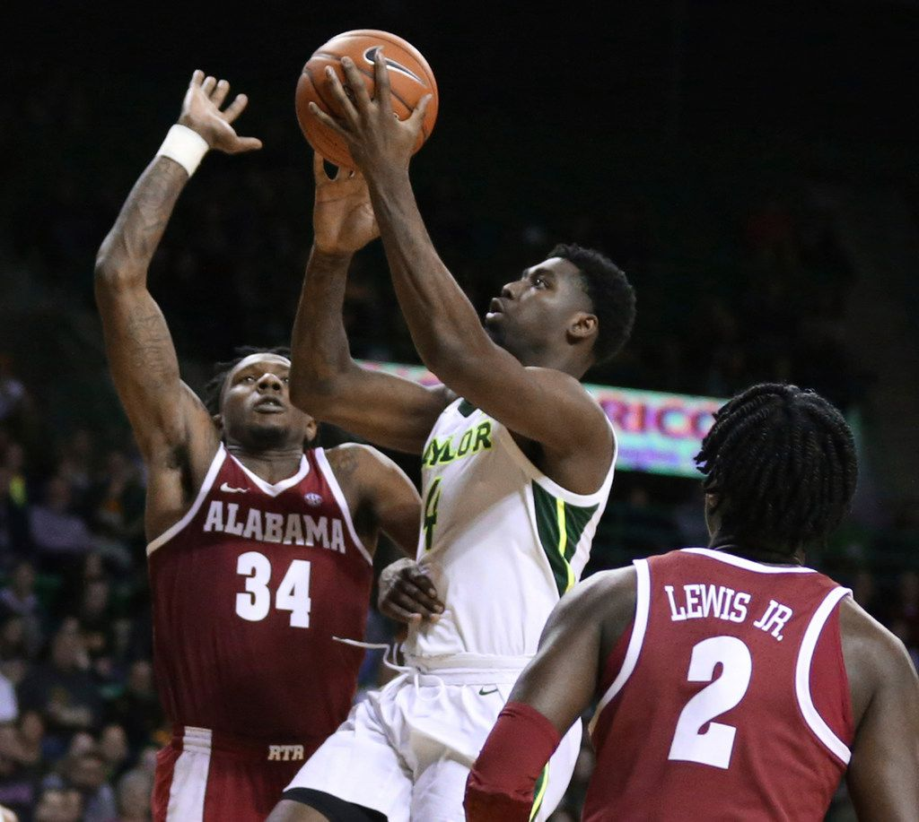 Baylor guard Mario Kegler (4) shoots over Alabama guards Tevin Mack, left, and Kira Lewis Jr., right, during the second half of an NCAA college basketball game, Saturday, Jan. 26, 2019, in Waco, Texas.