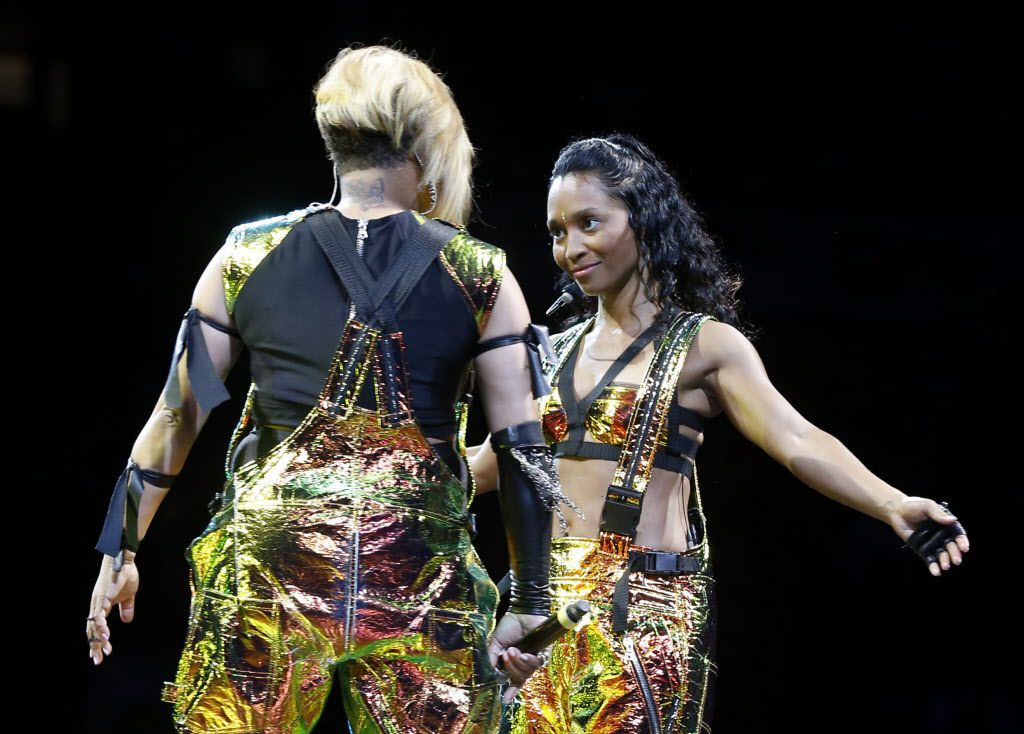 T-Boz (left) and Chilli (right) of TLC during a performance at American Airlines Center in Dallas, on Thursday, May 14, 2015.