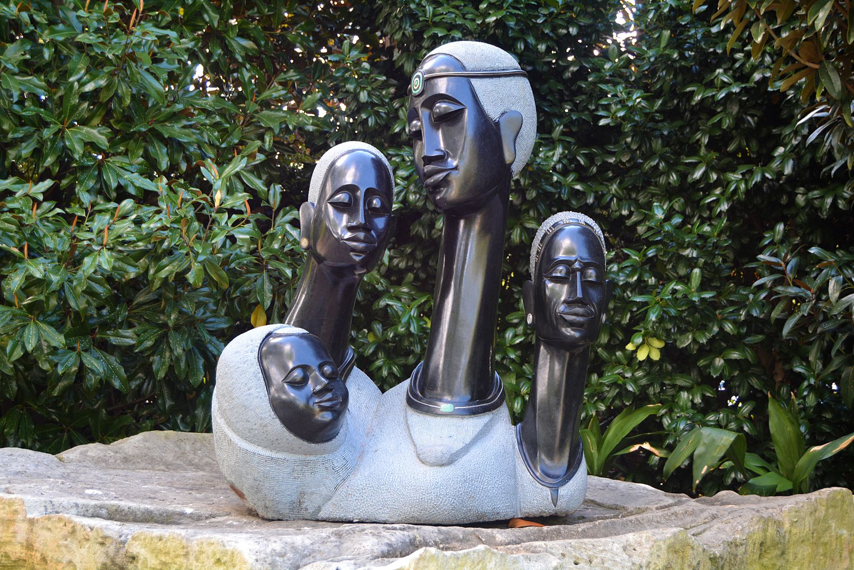 """Four Female Generations,"" by Joe Mutasa, is one of more than 100 Zimbabwean sculptures located throughout the Dallas Arboretum as part of its summer exhibit, ZimSculpt."