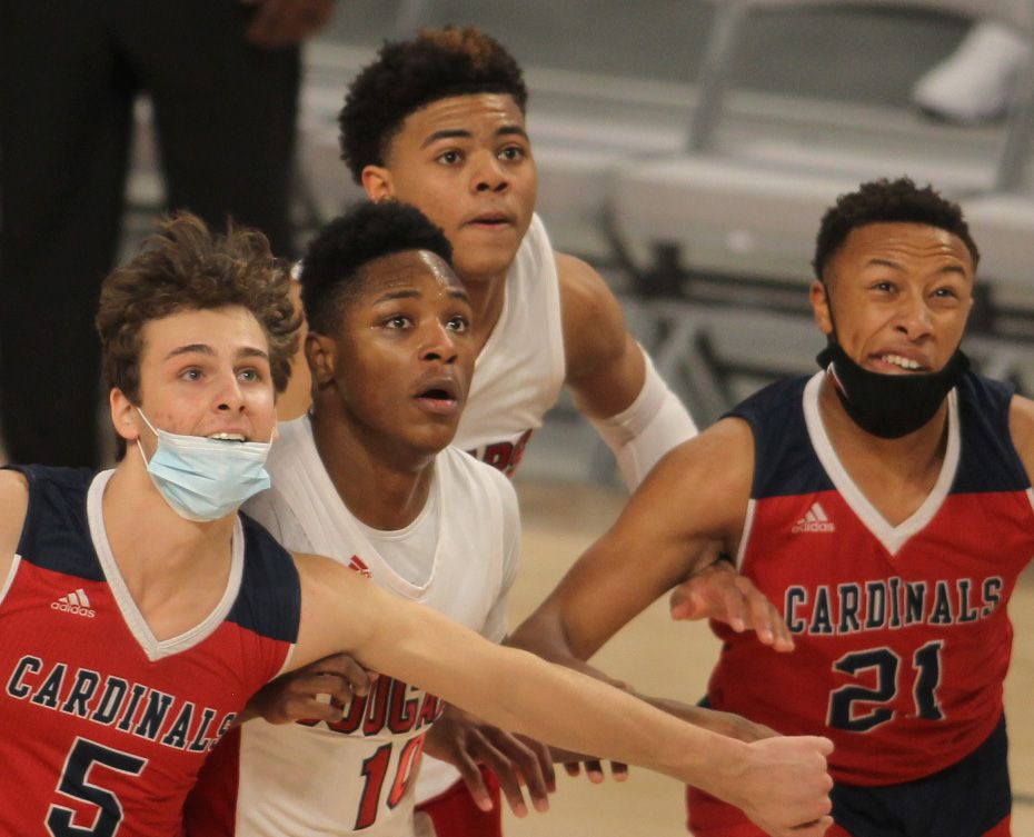 Pictured from left to right are Cardinals senior Nick Kendall (5), Cougars forward Trae Clayton (10), Cougars guard Keyonte George (1) and Cardinals sophomore Gabe Warren (21) on January 9, 2021 at a game between Plano John Paul ll and iSchool of Lewisville.