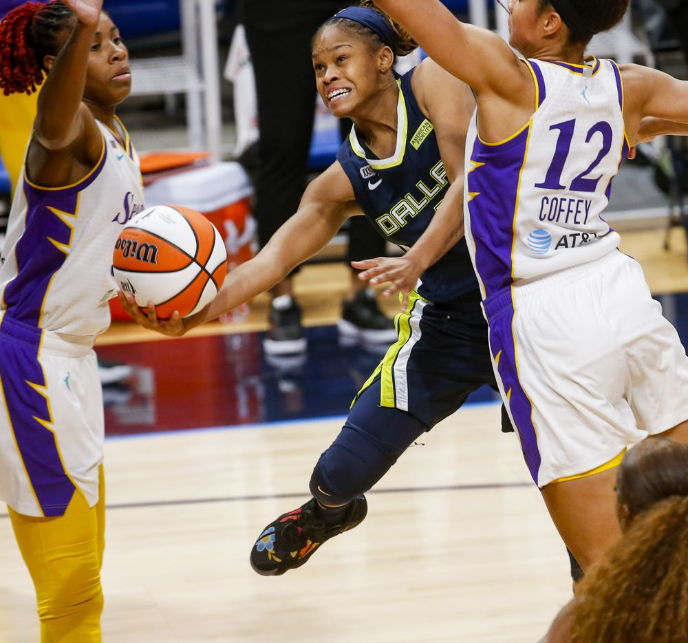 Dallas Wings guard Moriah Jefferson (4) is blocked by the Los Angeles Sparks defense in the fourth quarter at College Park Center on Tuesday, June 1, 2021, in Arlington. (Juan Figueroa/The Dallas Morning News)