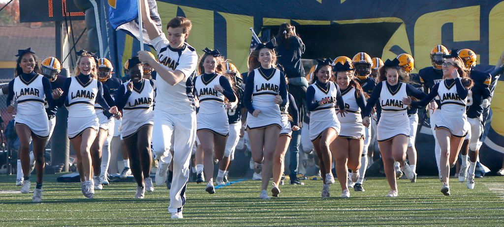 Members of the Arlington Lamar cheerleaders storm the field as they lead Vikings players onto the field prior to the opening kickoff against Midland Lee. The two teams played their Class 6A Division l area round football playoff game at Cravens Field on the campus of Lamar High School in Arlington on November 23, 2019. (Steve Hamm/ Special Contributor)