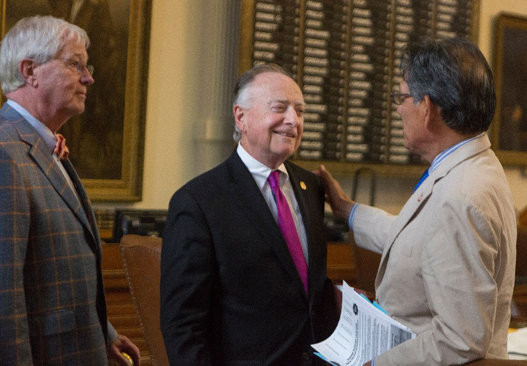 Rep. Charlie Geren, R-Fort Worth, Rep. Dan Flynn, R-Canton, and Rep. Roberto Alonzo, D-Dallas, speak on the House floor after the preliminary approval of House Bill 3158 which amends the provisions of law governing the pension funds for police officers and fire fighters in Dallas, at the Texas Capitol in Austin, Wednesday, May 3, 2017.