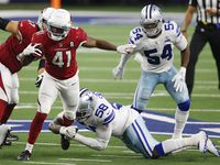 Dallas Cowboys defensive end Aldon Smith (58) tackles Arizona Cardinals running back Kenyan Drake (41) on a run play during the third quarter of play at AT&T Stadium on Monday, October 19, 2020 in Arlington, Texas.