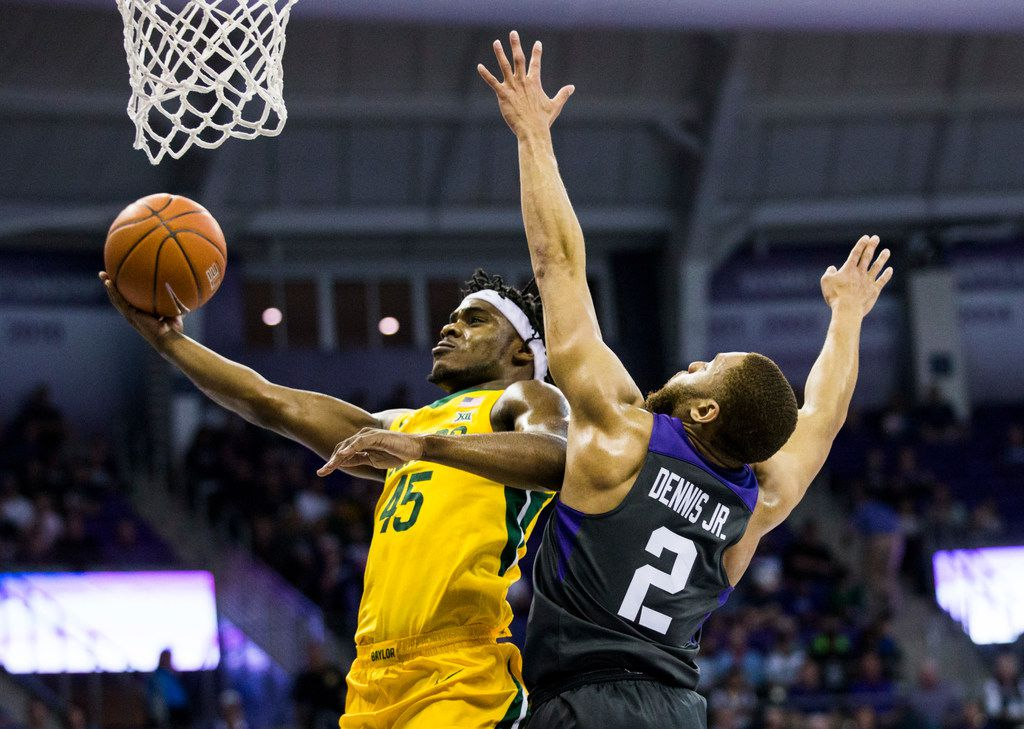 Baylor Bears guard Davion Mitchell (45) goes up for a shot ahead of TCU Horned Frogs guard Edric Dennis (2) during the first half of an NCAA mens basketball game between Baylor and TCU on Saturday, February 29, 2020 at Ed & Rae Schollmaier Arena on the TCU campus in Fort Worth.