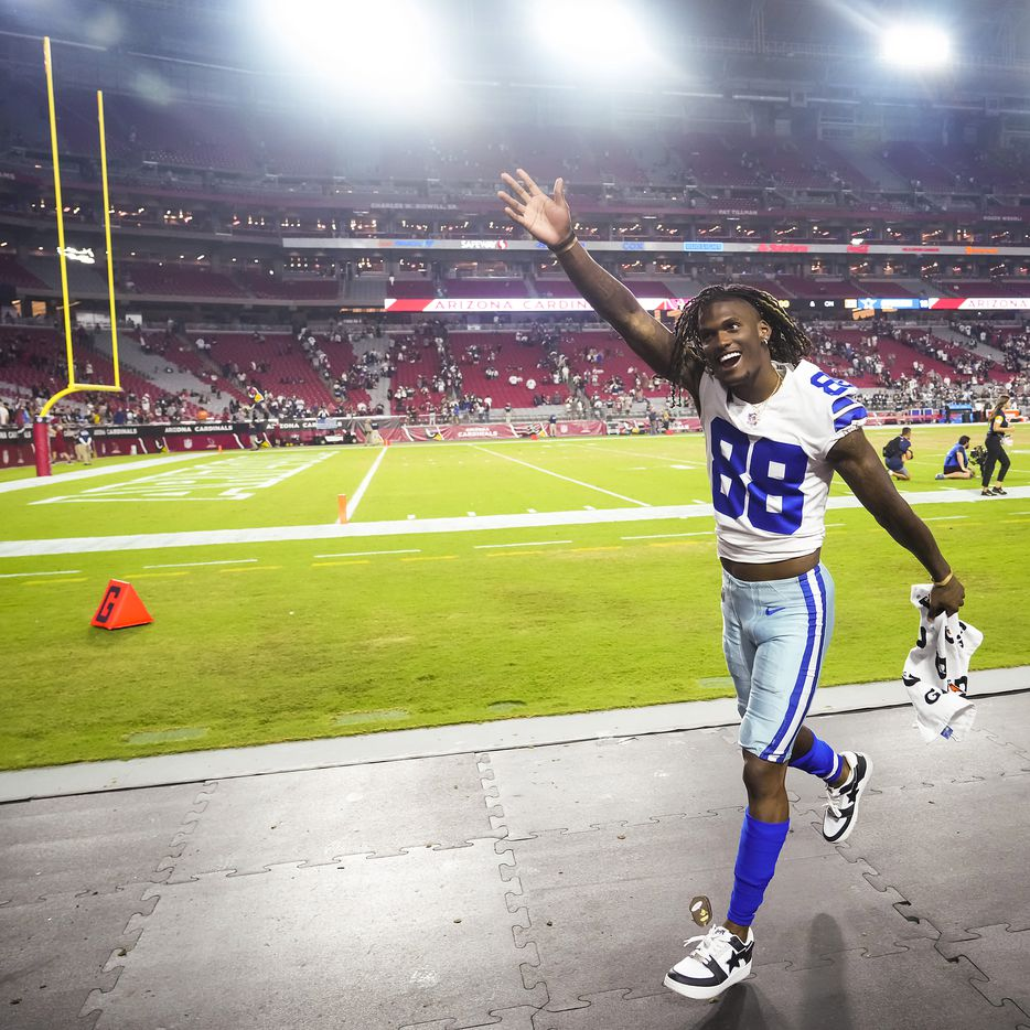 Dallas Cowboys wide receiver CeeDee Lamb waves to fans as he leaves the field after during a preseason NFL football game against the Arizona Cardinals at State Farm Stadium on Saturday, Aug. 14, 2021, in Glendale, Ariz.