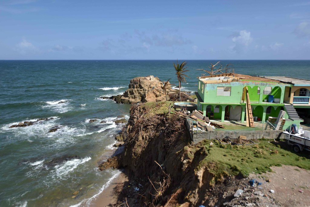 View of a destroyed house in Yabucoa, in the east of Puerto Rico, on September 28, 2017.  The US island territory, working without electricity, is struggling to dig out and clean up from its disastrous brush with hurricane Maria, blamed for at least 33 deaths across the Caribbean.